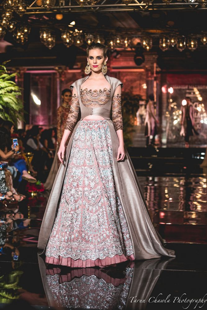 """All roads led to Taj Palace in New Delhi yesterday, half of which came to see Manish Malhotra's new bridal collection titled """"The Persian Story"""" and half of which came to get a peek at Fawad Khan & Deepika Padukone...."""