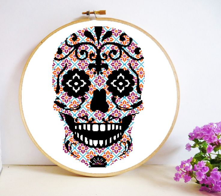 Isn't this Sugar Skull Cross Stitch pattern amazing? You'll definitely want to keep up throughout the rest of the year