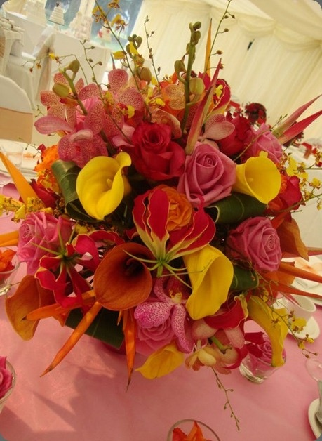 Brilliant flower arrangement of gloriosa lily, yellow calla lily,  roses, orchids and heliconia by love lily