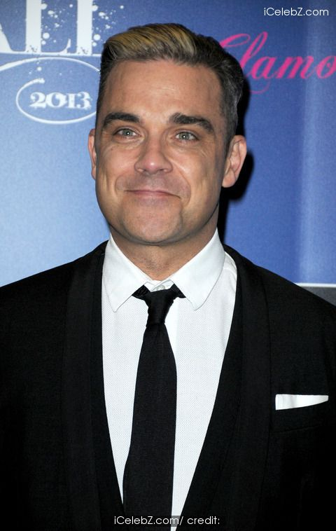 Robbie Williams  http://www.icelebz.com/celebs/robbie_williams/photo1.html