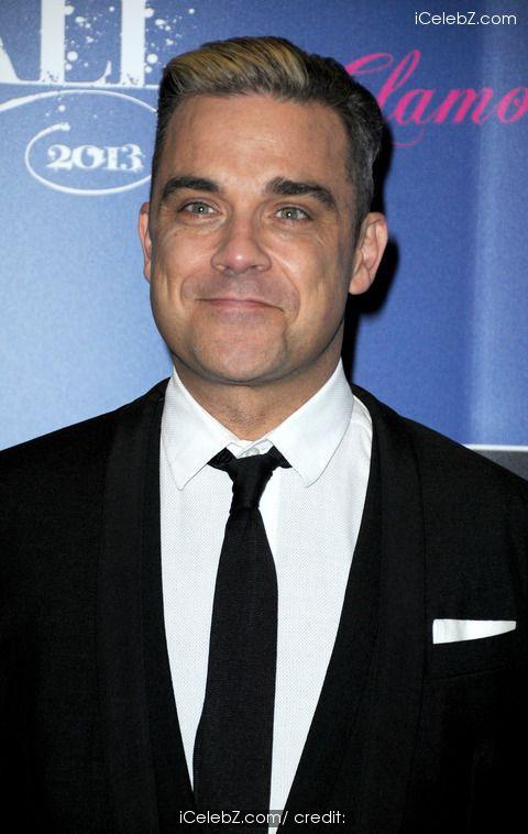 Robbie Williams  http://www.icelebz.com/celebs/robbie_williams/photo1.html