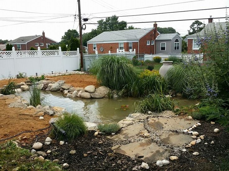30x11 pond installation - 4 days later in Bucks County, PA. #pond #waterfall #backyard #landscaping #garden
