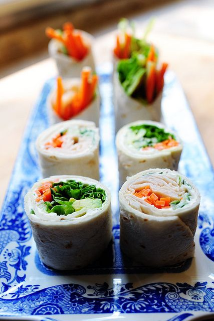 "Pioneer Woman: Tortilla Rollups that look a little like sushi. Yummy and fresh!  Fun and easy dinner idea for the kids - they can pick their own fillings. :)  Also might taste great using cream cheese, salsa, and a little finely shredded cheese as the ""spread"", then add taco fillings."