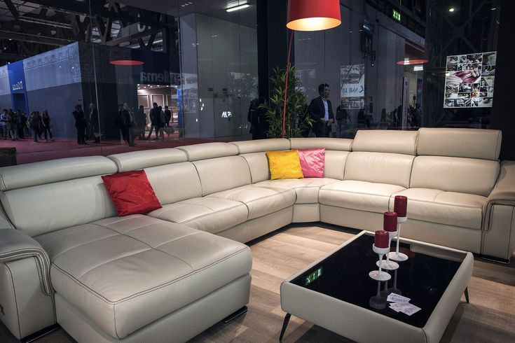 Large White Sectional Sofa Coupled with Bright Red Floor Lamp