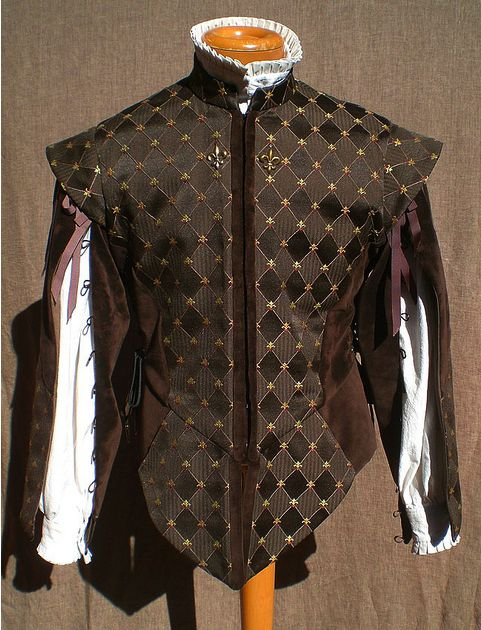 Handsome fleur-de-lys doublet. This in a navy with white or silver  fleurs would be pretty.  Add lighter blue trim on the arms and down the front and it would be GORGEOUS!