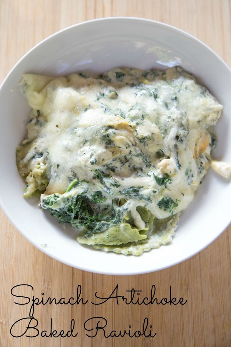 Spinach Artichoke Baked Ravioli Recipe - Need a new dinner addiction? Spinach artichoke dip, over ravioli with shredded cheese melted all over it.