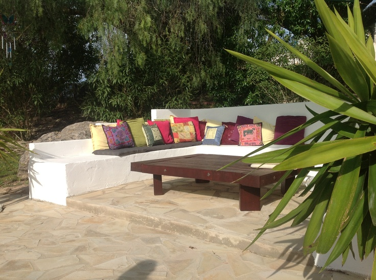 The outdoor lounge is filled with multiple colored pillows.  A comfortable area where you have the sun shining untill 10 minutes before sunset.  Consider this place as an extra gift!
