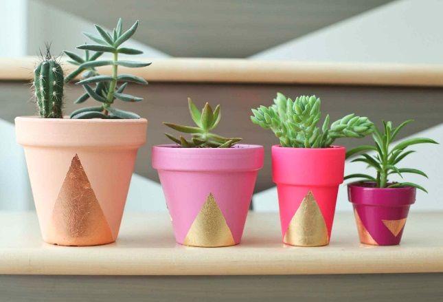 Transform terracotta pots with gold paint.