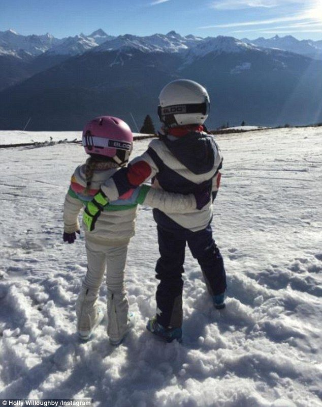 Cute kids:Holly Willoughby took to Instagram on Friday to share a rare snap of her two eldest children whilst on a fun family skiing trip in an undisclosed location