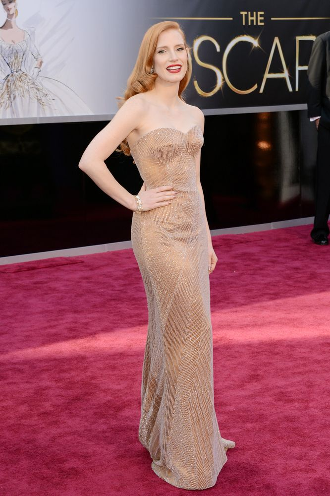 Jessica Chastain wears Armani Privé dress, Christian Louboutin shoes and Harry Winston jewelry. Oscars, 2013