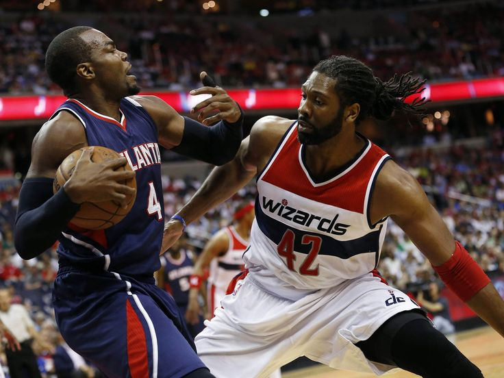 Atlanta Hawks forward Paul Millsap (4) and Washington Wizards forward Nene (42) battle for the ball in the first quarter in game four of the second round of the NBA Playoffs. at Verizon Center. Geoff Burke, USA TODAY Sports
