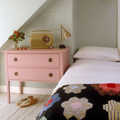 a snug alcove for the bed.  vintage accessories to an old chest of drawers painted in a pretty faded shade of pink | photograph Red Cover / Henry Wilson