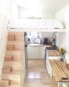 A tiny house with 2nd loft used as closet area and soaking tub. Built by Brevard Tiny House Company. Owned and shared by Genna Poletti.