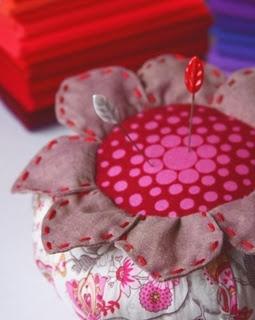 Blooming pin cushion.