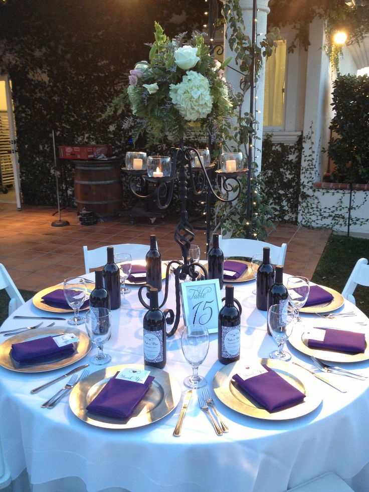 Table setting. Wedding. Purple napkins. Silver chargers ...