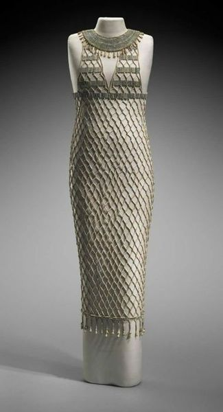 Beadnet dress | Egyptian Old Kingdom, Dynasty 4, reign of Khufu |2551–2528B.C.    Depictions of women in Egyptian art occasionally feature garments decorated with an overall lozenge pattern. This design is believed to represent beadwork, which was either sewn onto a linen dress or worked into a separate net worn over the linen. This beadnet dress is the earliest surviving example of such a garment. It has been painstakingly reassembled from approximately seven thousand beads found in an…