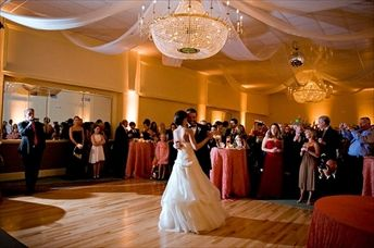 A newly married couple has their first dance in the Banquet Hall.