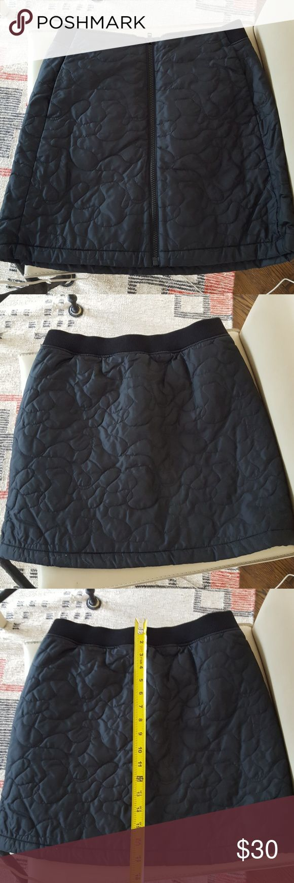 """Beautiful Uniqlo quilted skirt Never worn but took tags off. There is no size confirmation but I bought as a """"Small"""". Fleece lined, full zipper , two side pockets . Fits just above the knee Uniqlo Skirts Midi"""