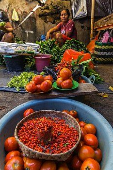 Women selling fresh fruit, vegetables, fish and spices in Larantuka, the capital…