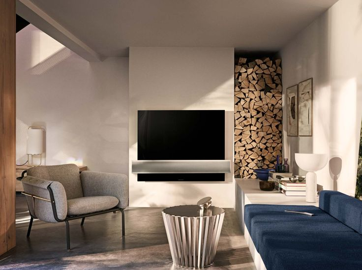 BeoVision Eclipse - 4K HDR OLED and the world's best TV sound.   Bang & Olufsen
