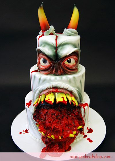 I'd have paid money to see reactions to this cake.    Horned Devil Halloween Wedding Cake by Pink Cake Box