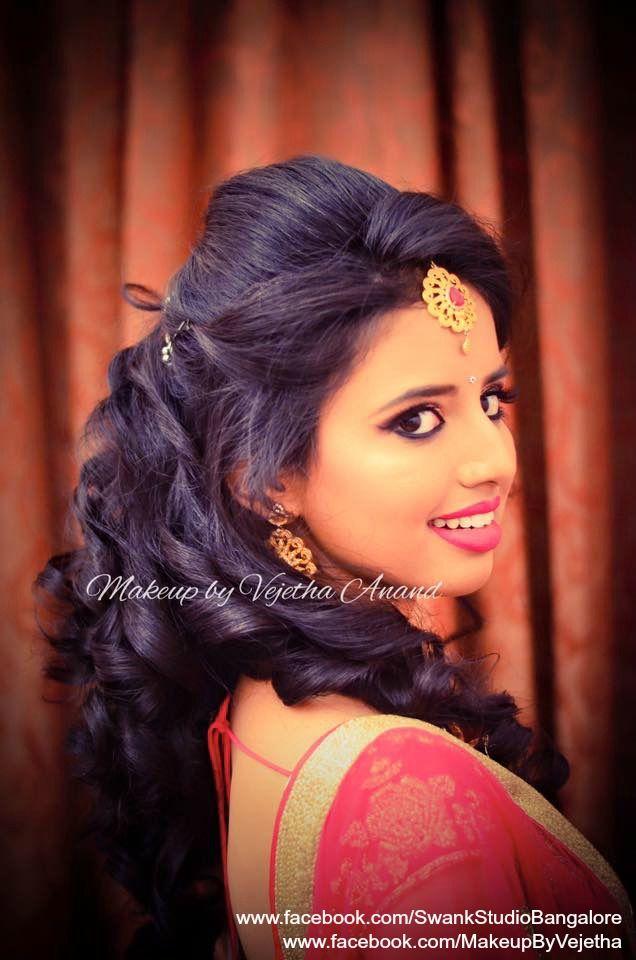 Ashwini looks dream like for her reception. Makeup and hairstyle by Vejetha for Swank Studio. Photo credit: Manish Ananda. Red lips. Bridal lehenga. Bridal jewelry. Bridal hair. Curls. Indian Bridal Makeup. Indian Bride. Gold Jewellery. Tamil bride. Telugu bride. Kannada bride. Hindu bride. Malayalee bride. Find us at https://www.facebook.com/SwankStudioBangalore