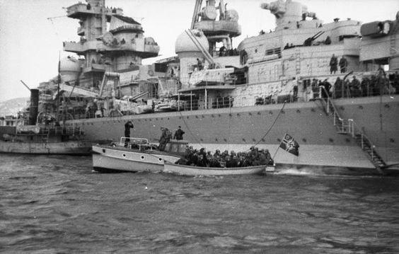 Midship view of German Admiral Hipper heavy cruiser landing troops in Trondheim, Norway in 1940.