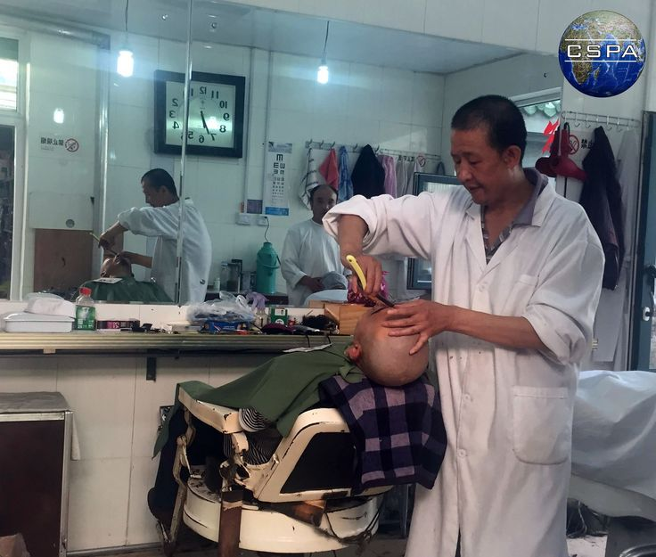 Barber shop. Muslim district in Xining. Photo by Patrycja Pendrakowska. #barber #shop #fryzjer #people #man #men #chiny #china #people #culture #lato #wakacje2016 #summer #white #life #travel #podróż #fareast #chinese #asian #instagrammers #followback #nofilter #holiday #amazing #hair #work #hairdresser #cspa #pendrakowska #coordinator