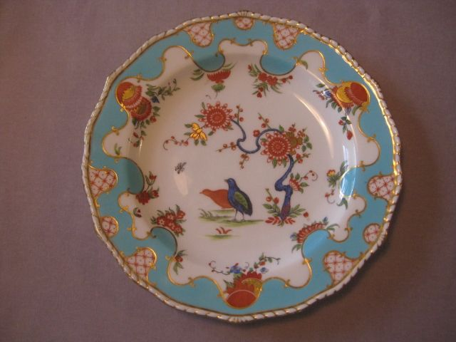 "A fine Derby plate  with a gilt framed pale blue border and decorated to the centre with the ""two quail ""  pattern.  Impressed mark and printed mark. Also  Tiffany & Co. Circa  1880     Width  8 3/4"""