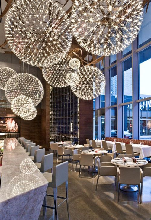 Some people choose to have a special moment at restaurant better than at home. Futuristic restaurant interior with sparkle lamp decoration add the happiness of that moment. For that reason, Urszula Tokarska and Stephen R. Pile Architect use incredible lighting fixtures called The Raimond Lamps from Moooi when they design Aria Restaurante in Toronto, Canada.