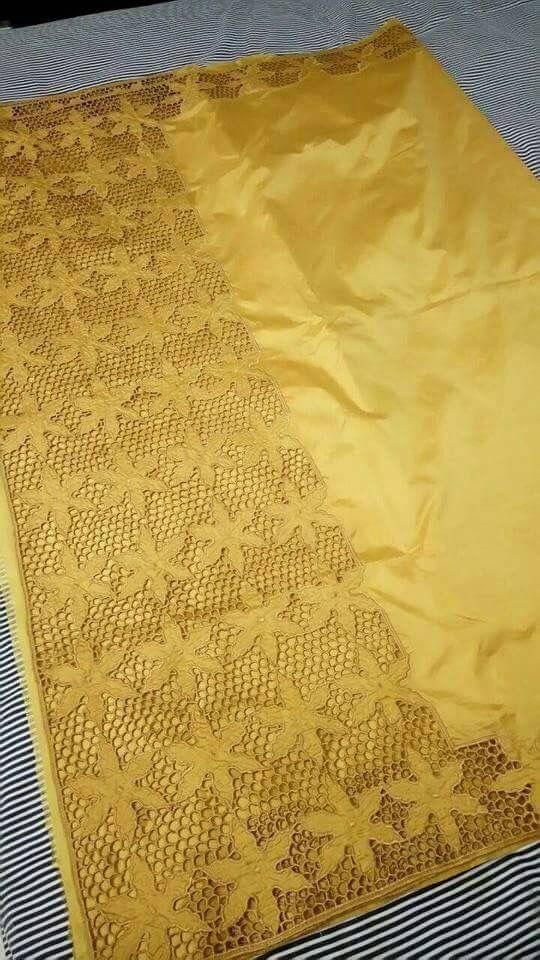 Yellow tussar cutwork saree