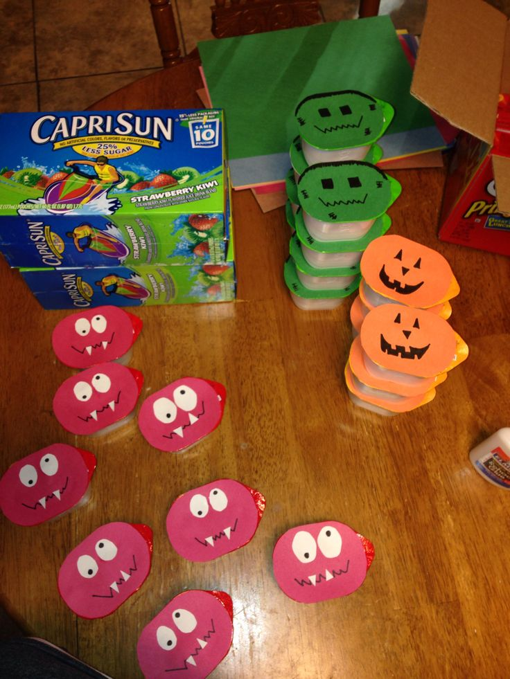Casen's Preschool Snacks Halloween Individual Pringles with construction paper monsters, jack o'lanterns, and Frankensteins