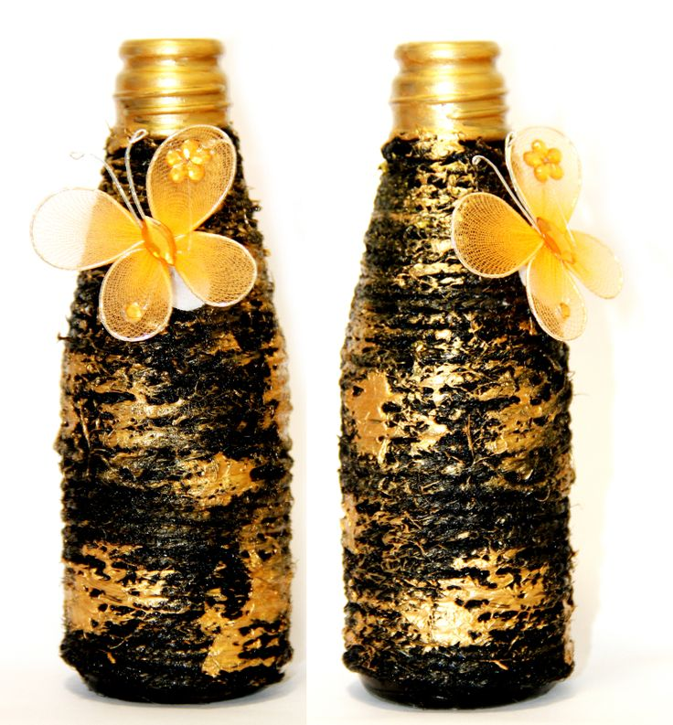 Abstract - Jute rope tied around with black colour painted on it and final touch with gold colour. Made out of empty sauce bottle.