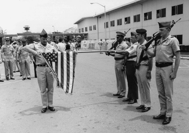 FILE - In this March 29, 1973 file photo, the American flag is furled at a ceremony marking official deactivation of the Military Assistance Command-Vietnam (MACV) in Saigon, after more than 11 years in South Vietnam. While the fall of Saigon in 1975 — with its indelible images of frantic helicopter evacuations — is remembered as the final day of the Vietnam War, March 29 marks an anniversary that holds greater meaning for many who fought, protested or otherwise lived the war. (AP…