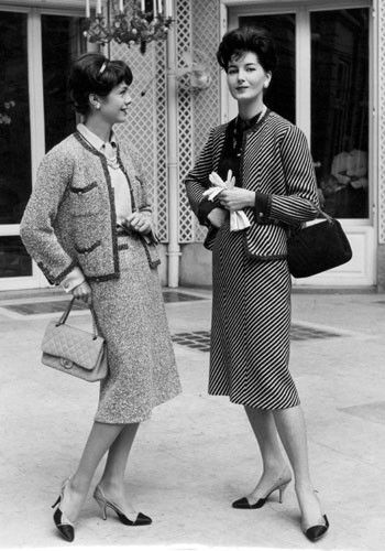 Chanel in the 1950's- Chanel returned in popularity after the war partly due to her Chanel suit. Models wearing Chanel suits in the 1950s