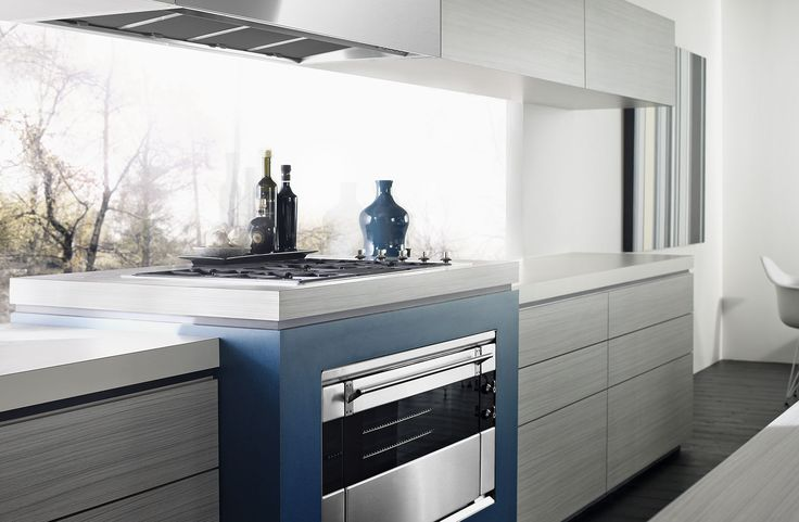 Light grey timber grain look cupboards with blue feature around oven.