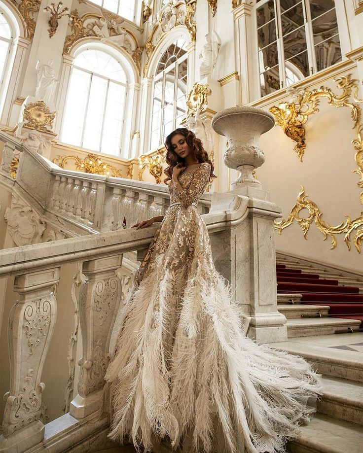 As far as we're concerned, this feathered Malyarovaolga gown and splendent surroundings are gilded perfection!  Photography by Janna Kuzko Credit: WedLuxe Magazine