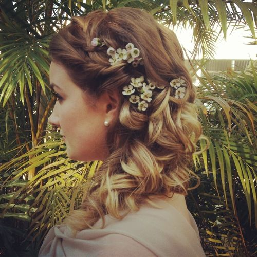 Half up with braid, curls and a dash of baby's breath.