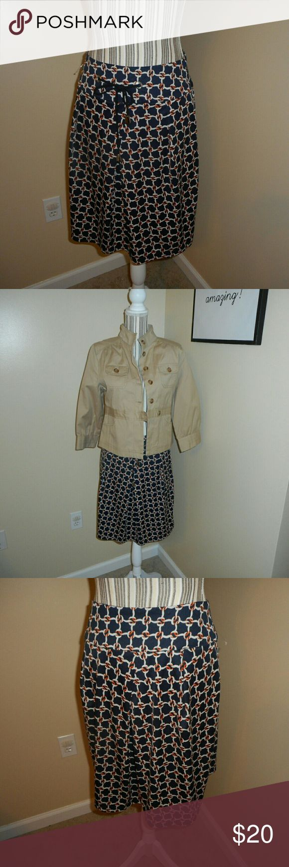 EUC! Natural Beauty Basic Nautical Skirt Sz. M EUC! Natural Beauty Basic Nautical Skirt Sz. M Only skirt is for sale in this listing. Coat is to show what it would look like as an outfit. Cute blue, white, and orange skirt with tie Zip up back natural beauty basic Skirts