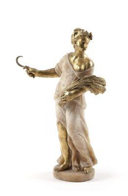 Sommaren med i högra handen skära och på vänstra armen kärve, gjord av huggen alabaster och gjuten brons. Från 1800 cirka.