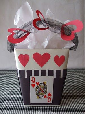 gift basket - tulle handle with paper shapes strung thru. Neat.