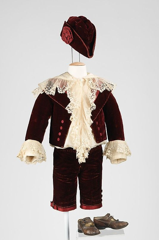 The 1885 Little Lord Fauntleroy suit was a prominent style for boy's dress attire among the privileged classes.  The shirt in this ensemble is particularly noteworthy, made of fine silk with an abundance of well-made machine-made lace ruffles.  The shirt has been sewn in a manner that will maintain the blouson effect regardless of the child's movements.