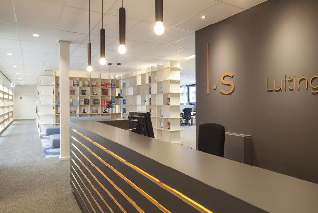 Reception desk. Bookcases. Publisher. Office: interior design and project management by Heyligers design+projects. www.h-dp.nl