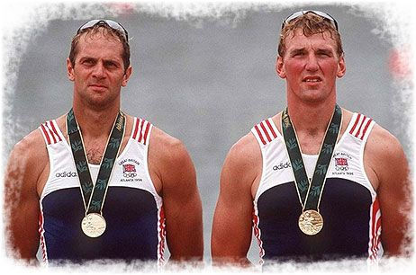1996 Godfrey kit is again worn by the GB Rowing squad at the Atlanta Olympic games, again made under license for Adidas. Redgrave and Pinsent win Gold again, providing the GB Olympic squad with its only gold medal at the games.