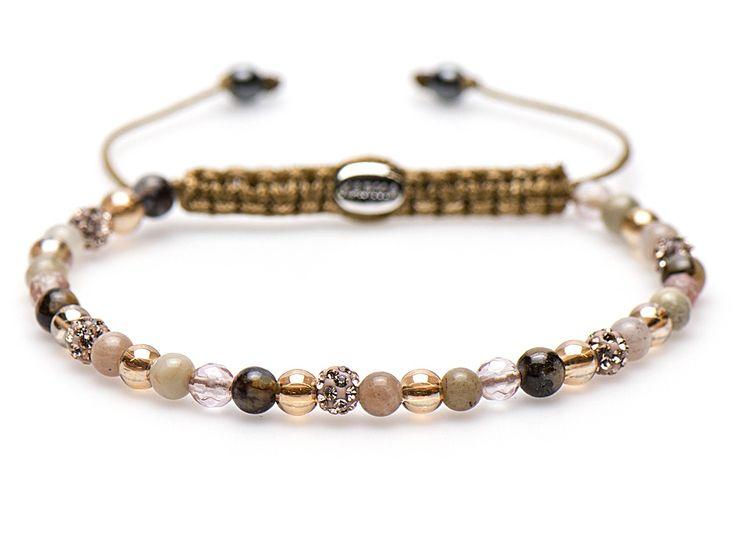 Karma Armband 'Spiral Unforgettable Smile' XXS 84166. Trendy en sprankelende KARMA armband met een lengte van 17-19 cm. De kralen in bruintinten zijn gemaakt van precosia kristallen en natuursteen.