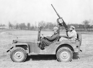 The 69 vehicles that were built on the pilot contract were known as the Bantam Model 60. This Model 60, outfitted with a machine gun, was photographed at Aberdeen Proving Grounds in March 1941. The scalloped doorway of the prototype has been replaced with a simpler opening, just as the elaborate fenders have been replaced with these simple flat versions. Patton Museum, Fort Knox, Kentucky