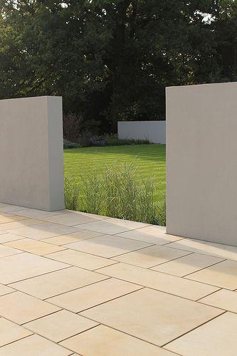 minimalist garden with simple gray walls