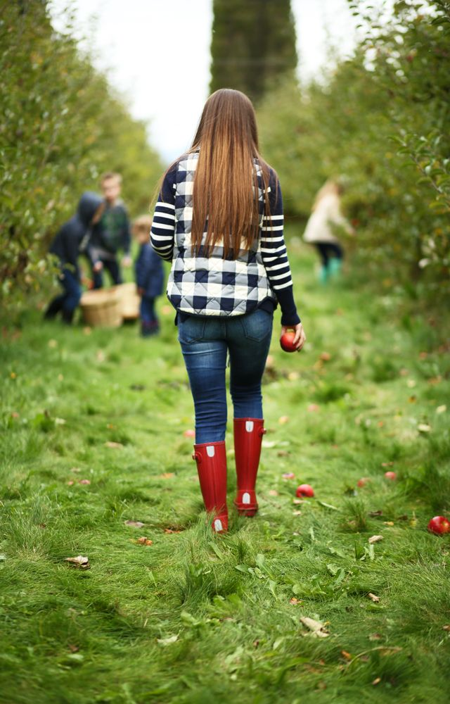 apple picking outfit plaid puffer vest and striped sweater red hunter boots