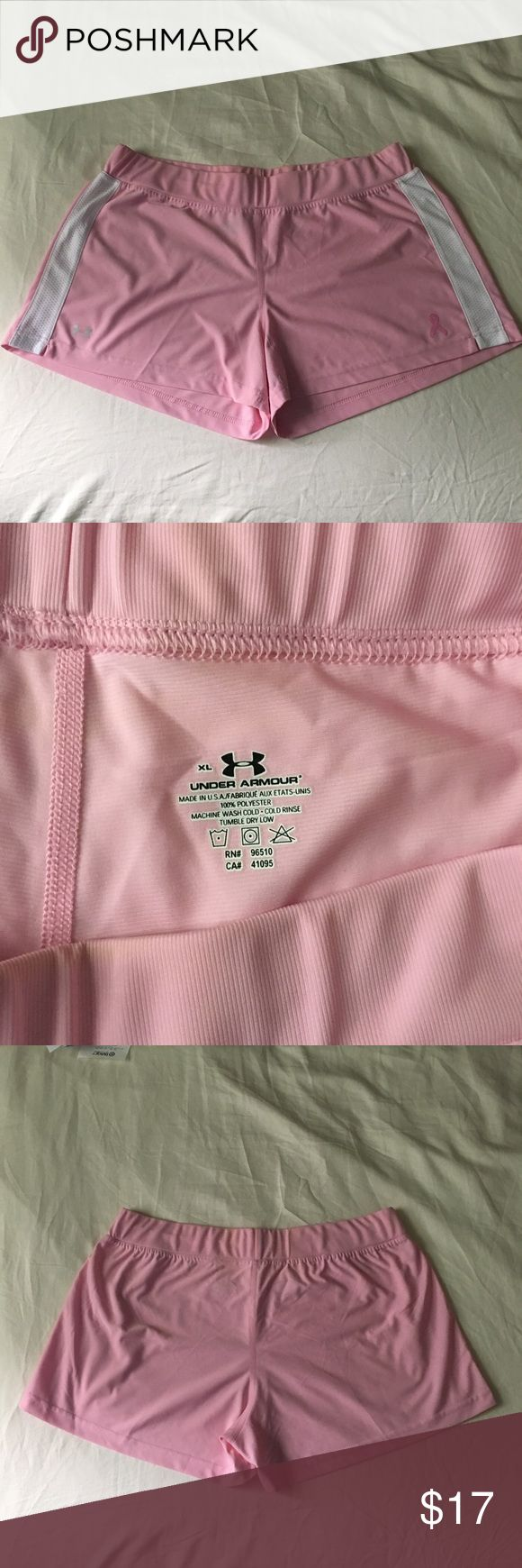 Under Armour Women's pink shorts XL Under Armour women's breast cancer awareness pink shorts. 100% polyester.   Size XL.   Purchased a few years ago, never worn (I was using them as inspiration to shed a few pounds!!) and then put in storage in a chest in my closet.   There is a VERY light discoloration on a couple parts of the waistband but it's not very noticeable. Cheaper on Ⓜ️! Under Armour Shorts