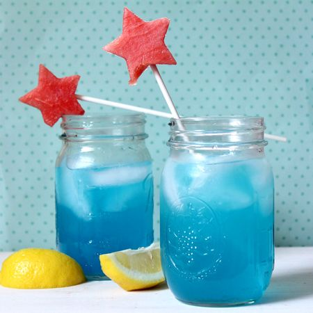 Blue lemonade cocktail with watermelon star garnishes. This patriotic drink can be made for adults (with the addition of blue Hawaiian Schnapps and Vodka) or kid-friendly (minus all the alcohol).